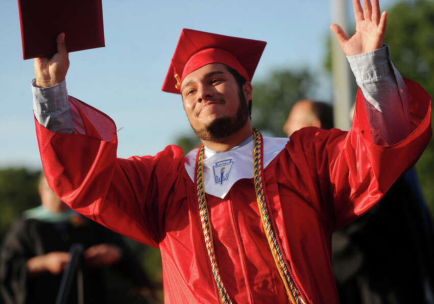 Graduate Elmar Barrios looks to his family after receiving his diploma at the Stratford High School graduation at Penders Field in Stratford, Conn. on Wednesday, June 15, 2016.
