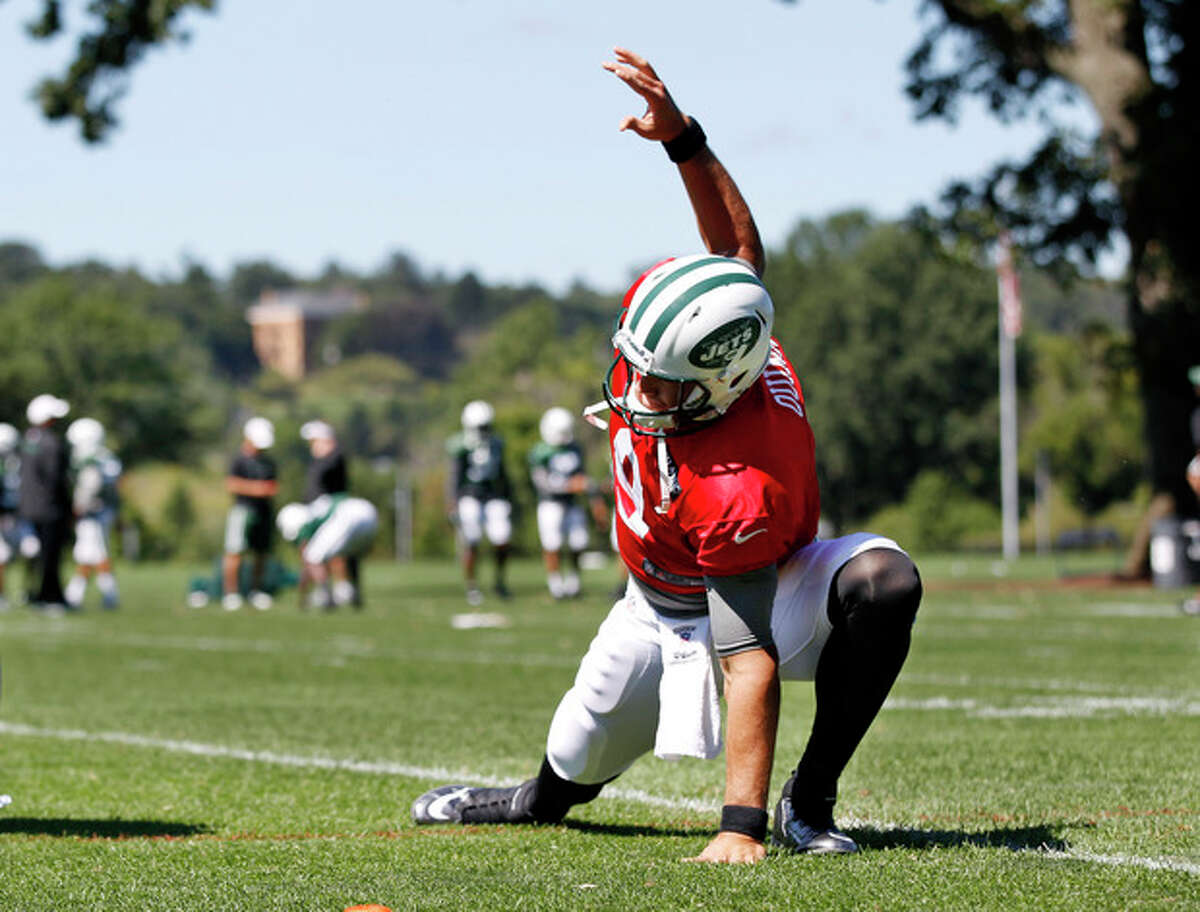 New York Jets quarterback Brady Quinn (9) stretches on the field during football practice in Florham Park, N.J. Wednesday, Sept. 4, 2013. (AP Photo/Mel Evans)