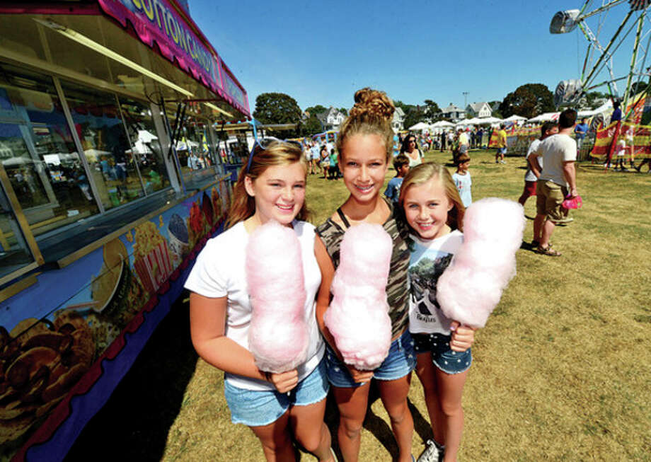 Bella Nixon, Lillian Breier and Eva Ebbsen enjoy cotton candy during the 36th annual Norwalk Oyster Festival Saturday. / (C)2013, The Hour Newspapers, all rights reserved