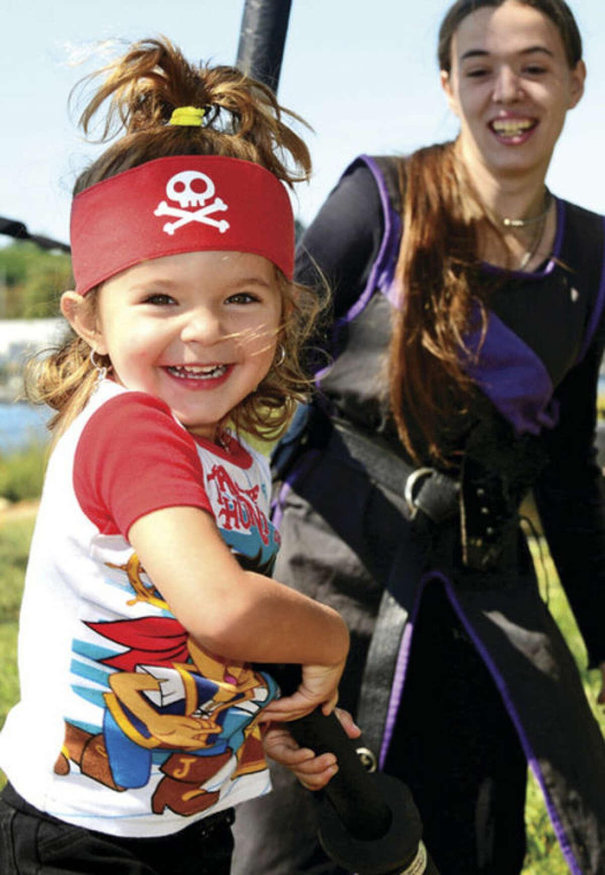 2 year old Savanna Eliasson enjoys visiting Pirate Cove during the 36th annual Norwalk Oyster Festival Saturday. Hour photo / Erik Trautmann