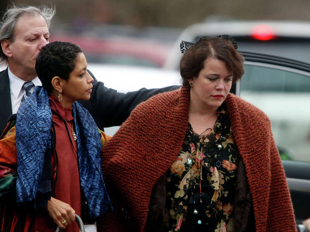 Veronique Pozner, right, arrives at a funeral service for her son, 6-year-old Noah Pozner, Monday, Dec. 17, 2012, in Fairfield, Conn. Noah Pozner was killed when Adam Lanza walked into Sandy Hook Elementary School in Newtown Friday and opened fire, killing 26 people, including 20 children. (AP Photo/Jason DeCrow)