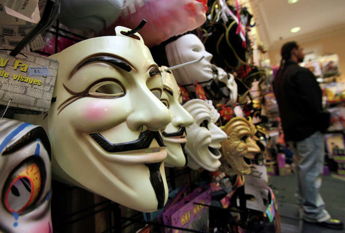FILE - In this Oct. 21, 2011 file photo, masks, including
