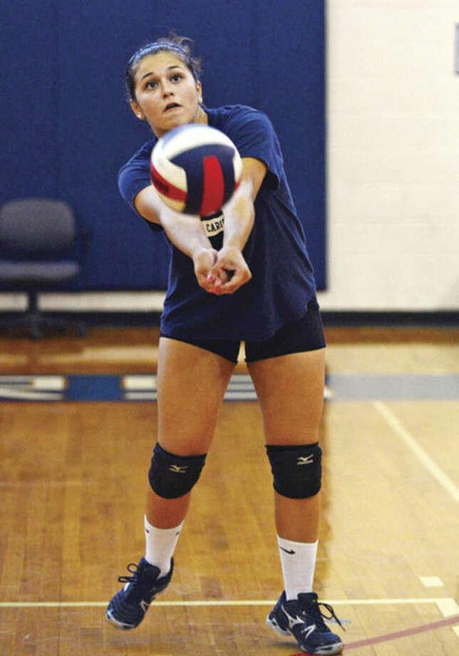Brien McMahon Volleyball captain Naomi Salamea practices Tuesday.Hour photo / Erik Trautmann