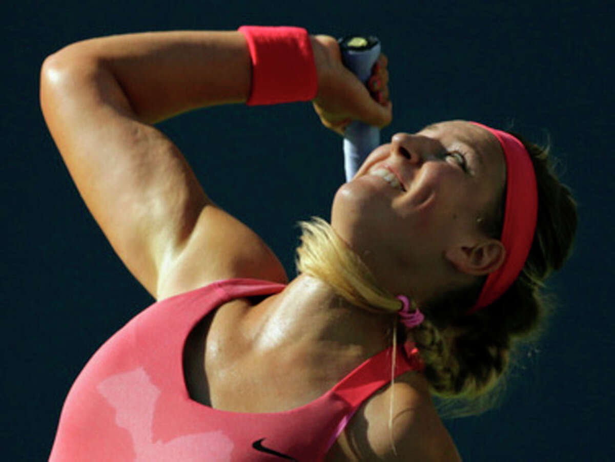 Victoria Azarenka, of Belarus, serves to Flavia Pennetta, of Italy, during the semifinals of the 2013 U.S. Open tennis tournament, Friday, Sept. 6, 2013, in New York. (AP Photo/Charles Krupa)