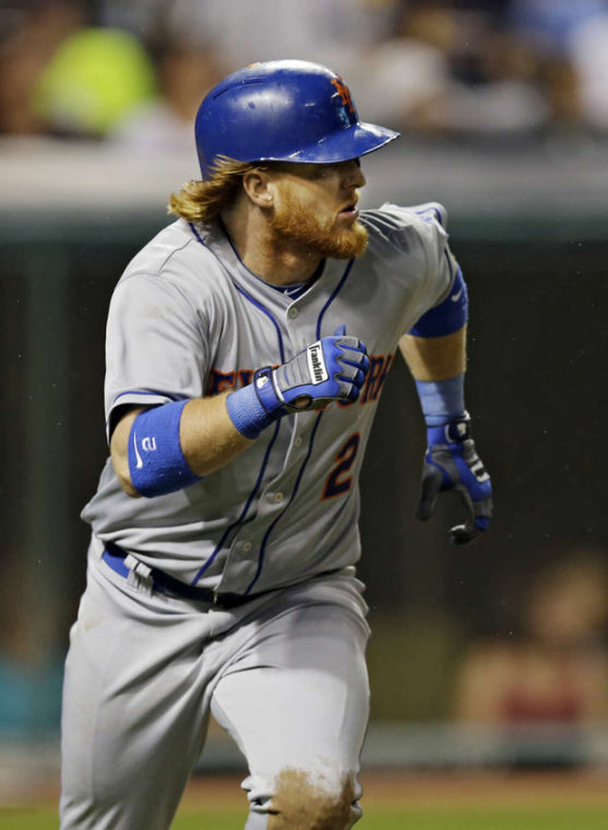 New York Mets' Justin Turner runs out a two-run double off Cleveland Indians relief pitcher Vinnie Pestano in the sixth inning of a baseball game Saturday, Sept. 7, 2013, in Cleveland. (AP Photo/Mark Duncan)