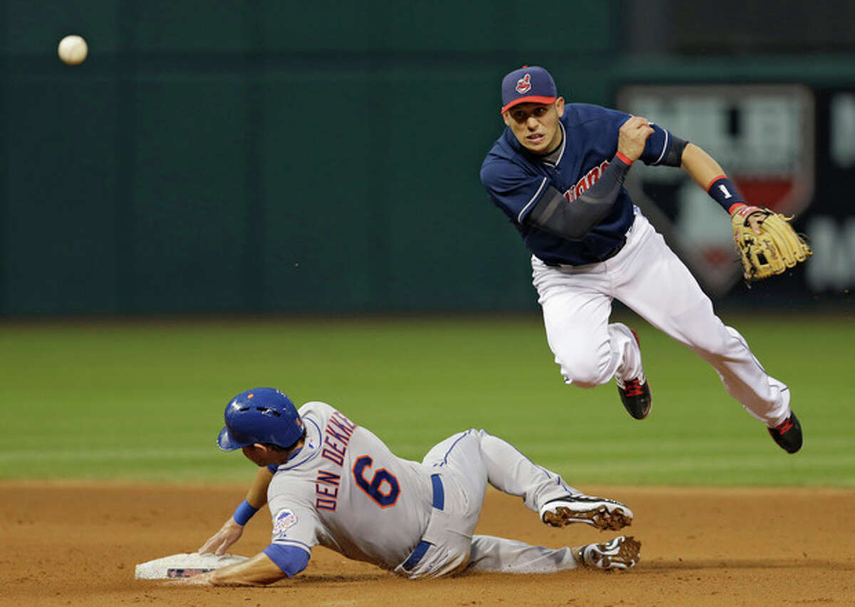Cleveland Indians shortstop Asdrubal Cabrera throws over New York Mets' Matt den Dekker (6) to complete a double play on Mets' Omar Quintanilla in the fifth inning of a baseball game Saturday, Sept. 7, 2013, in Cleveland. (AP Photo/Mark Duncan)