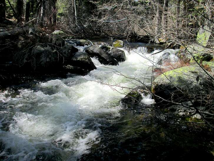 From near Meeks Bay at Lake Tahoe, the Meeks Creek Trail rises up along surging Meeks Creek, surging from fresh snowmelt, and up to Crags Lake and eventually the Pacific Crest Trail. You currently hit snow at Crags Lake, but it is melting off quickly.
