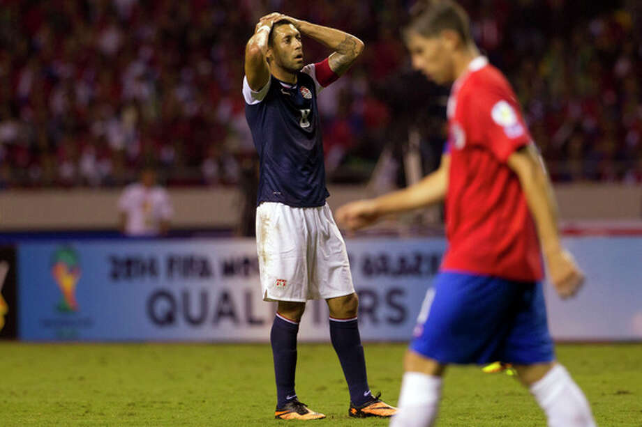 United States' Clint Dempsey pauses after missing a chance to score against Costa Rica at a 2014 World Cup qualifier soccer match in San Jose, Costa Rica, Friday, Sept. 6, 2013. (AP Photo/Moises Castillo) / AP