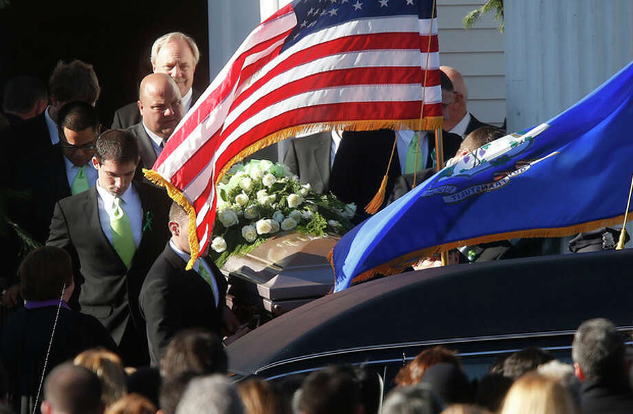A coffin bearing the body of Victoria Soto is carried out of Lordship Community Church after her funeral service, Wednesday, Dec. 19, 2012, in Stratford, Conn. Soto was killed when Adam Lanza walked into Sandy Hook Elementary School in Newtown, Conn., Dec. 14, and opened fire, killing 26 people, including 20 children, before killing himself.(AP Photo/Jason DeCrow) / FR103966 AP