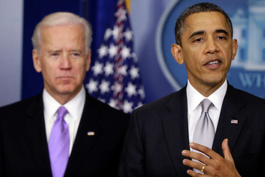 President Barack Obama stands with Vice President Joe Biden as he makes a statement Wednesday, Dec. 19, 2012, in the Brady Press Briefing Room at the White House in Washington, about policies he will pursue following the massacre at Sandy Hook Elementary School in Newtown, Ct. Obama is tasking Vice President Joe Biden, a longtime gun control advocate, with spearheading the effort. (AP Photo/Charles Dharapak) / AP