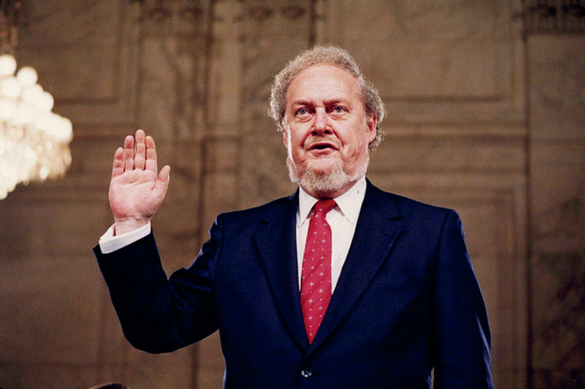 FILE - In this Sept. 15, 1987 file photo, Judge Robert Bork, nominated by President Reagan to be an associate justice of the Supreme Court, is sworn before the Senate Judiciary Committee on Capitol Hill at his confirmation hearing. Robert Bork, whose failed Supreme Court nomination made history, has died. (AP Photo/John Duricka)