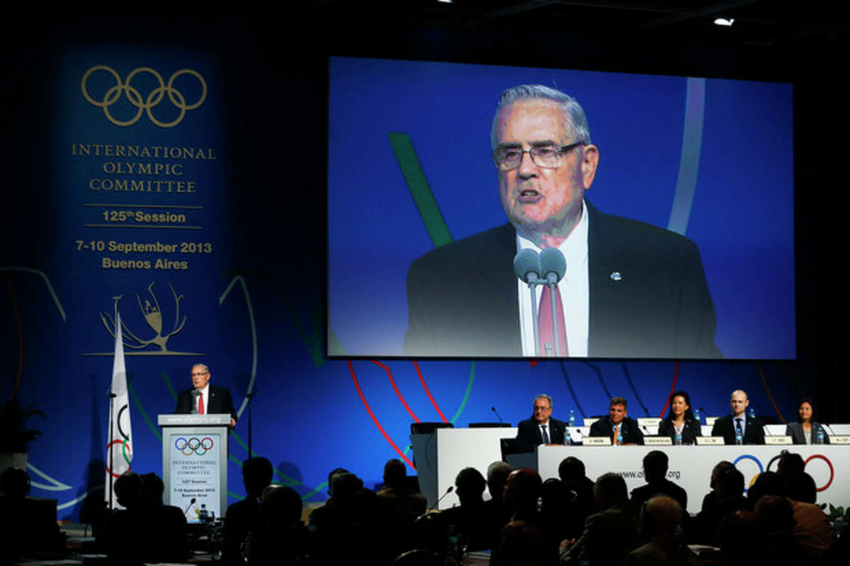 Don Porter, president of the International Softball Federation, speaks during the sports' presentation during the 125th IOC session in Buenos Aires, Argentina, Sunday, Sept. 8, 2013. During the meeting members will elect a new sport choosing between wrestling, squash and baseball, that is presenting a joint bid with softball.(AP Photo/Victor R. Caivano)