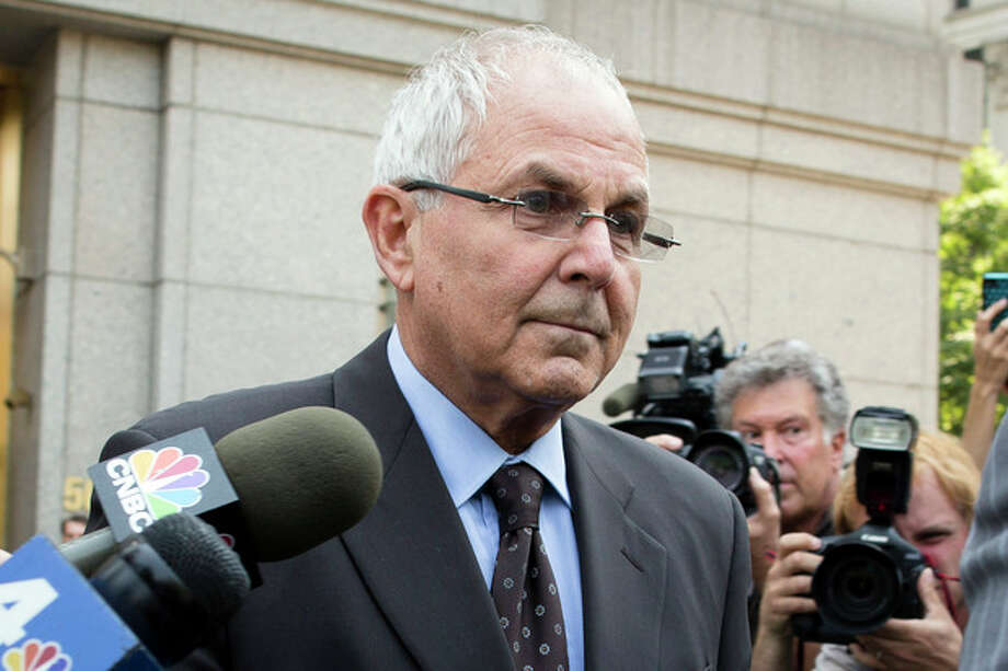 FILE - In this June 29, 2012 file photo, Peter Madoff leaves Federal Court in New York after pleading guilty to criminal charges. The suspense surrounding the sentencing of the brother of Ponzi king Bernard Madoff will largely be absent because a plea agreement makes a 10-year prison term all but certain. But drama will likely fill the courtroom Thursday, Dec. 20, 2012 in U.S. District Court in Manhattan anyway as 67-year-old Peter Madoff faces some of the heartbroken investors who lost their savings when the unprecedented fraud was revealed four years ago this month. (AP Photo/John Minchillo, File) / FR170537 AP