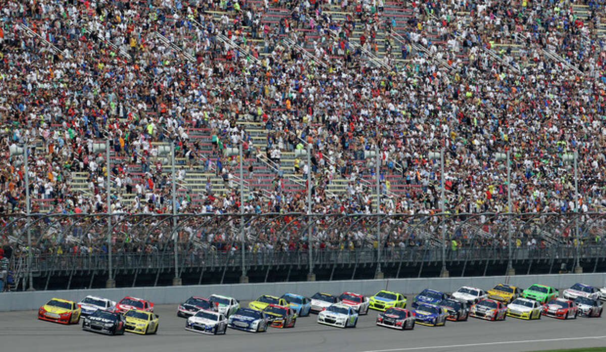 Pole sitter Joey Logano leads the field to the green flag during the NASCAR Sprint Cup series Pure Michigan 400 auto race at Michigan International Speedway in Brooklyn, Mich., Sunday, Aug. 18, 2013. (AP Photo/Paul Sancya)