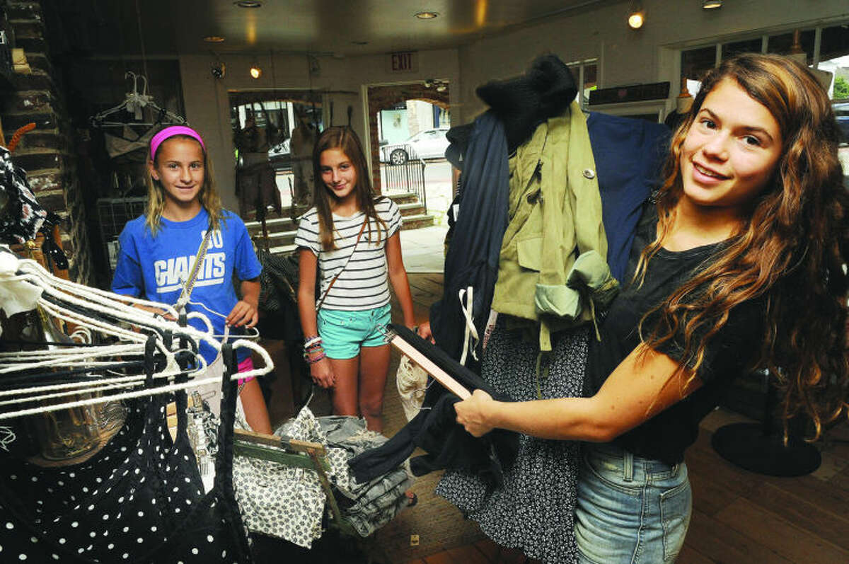 Lulu Shaffer stocks up on clothes Sunday with her friends, Lorie Costantino and Meg Kelly for tax free week prices at the Brandy Melville store in Westport. Hour photo/Matthew Vinci