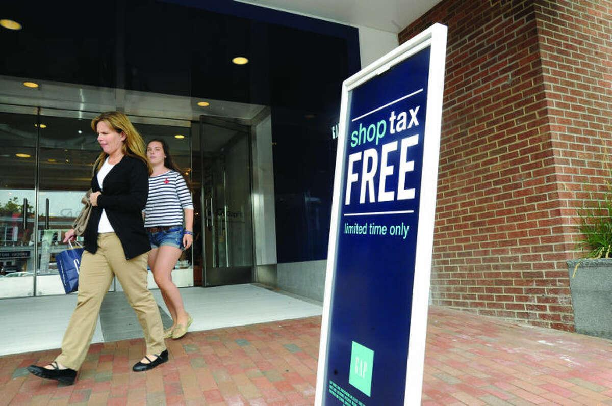Shoppers leave the Gap in Westport, Tax Free Week began on Sunday. Hour photo/Matthew Vinci