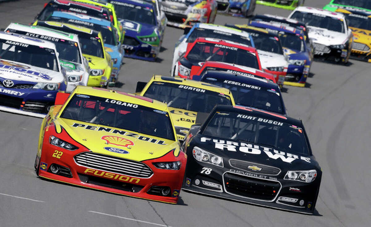 Pole sitter Joey Logano leads the field during the NASCAR Sprint Cup series Pure Michigan 400 auto race at Michigan International Speedway in Brooklyn, Mich., Sunday, Aug. 18, 2013. (AP Photo/Paul Sancya)