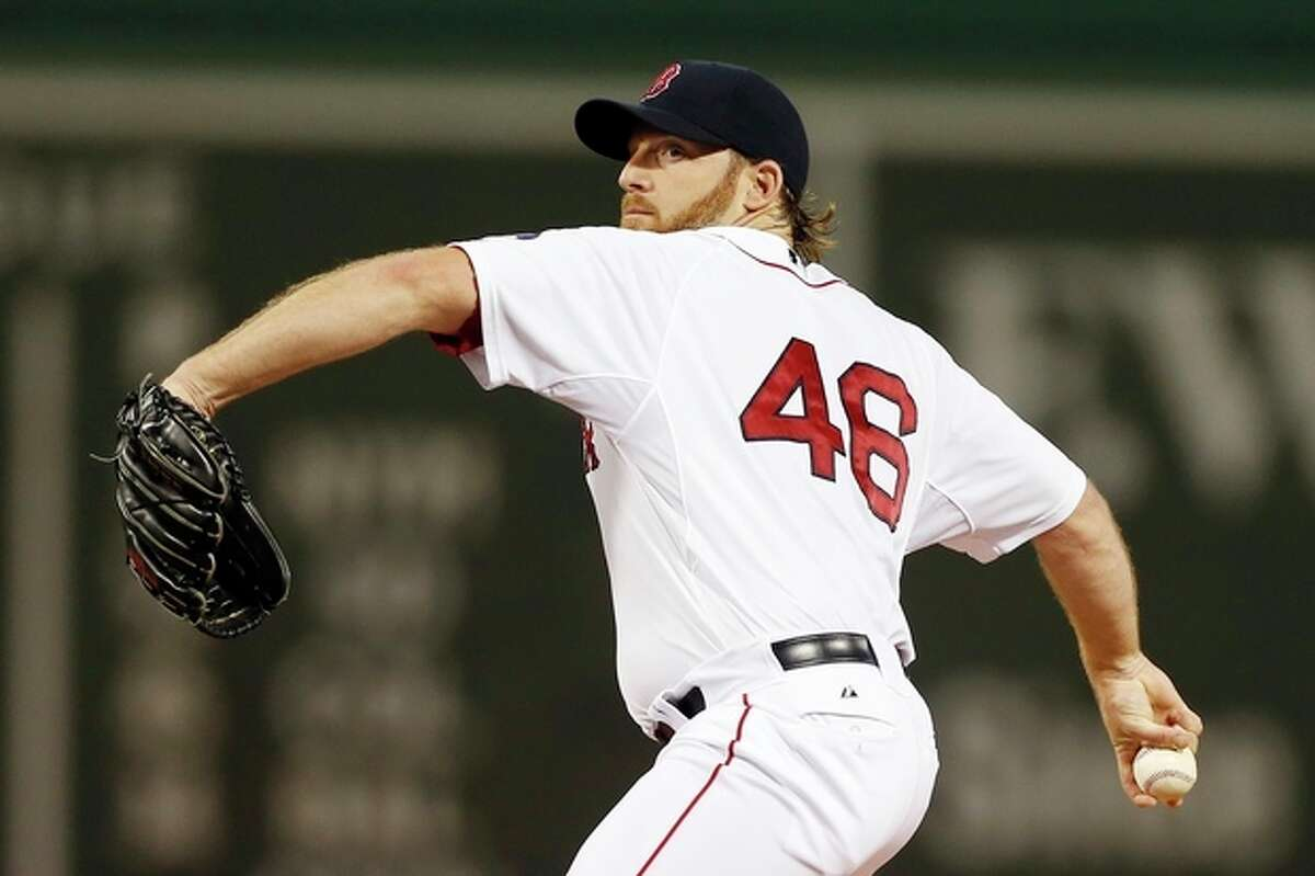 Boston Red Sox's Ryan Dempster pitches in the first inning of a baseball game against the New York Yankees in Boston, Sunday, Aug. 18, 2013. (AP Photo/Michael Dwyer)