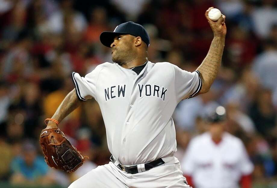 New York Yankees' CC Sabathia pitches in the first inning of a baseball game against the Boston Red Sox, Sunday, Aug. 18, 2013, in Boston. (AP Photo/Michael Dwyer) / AP