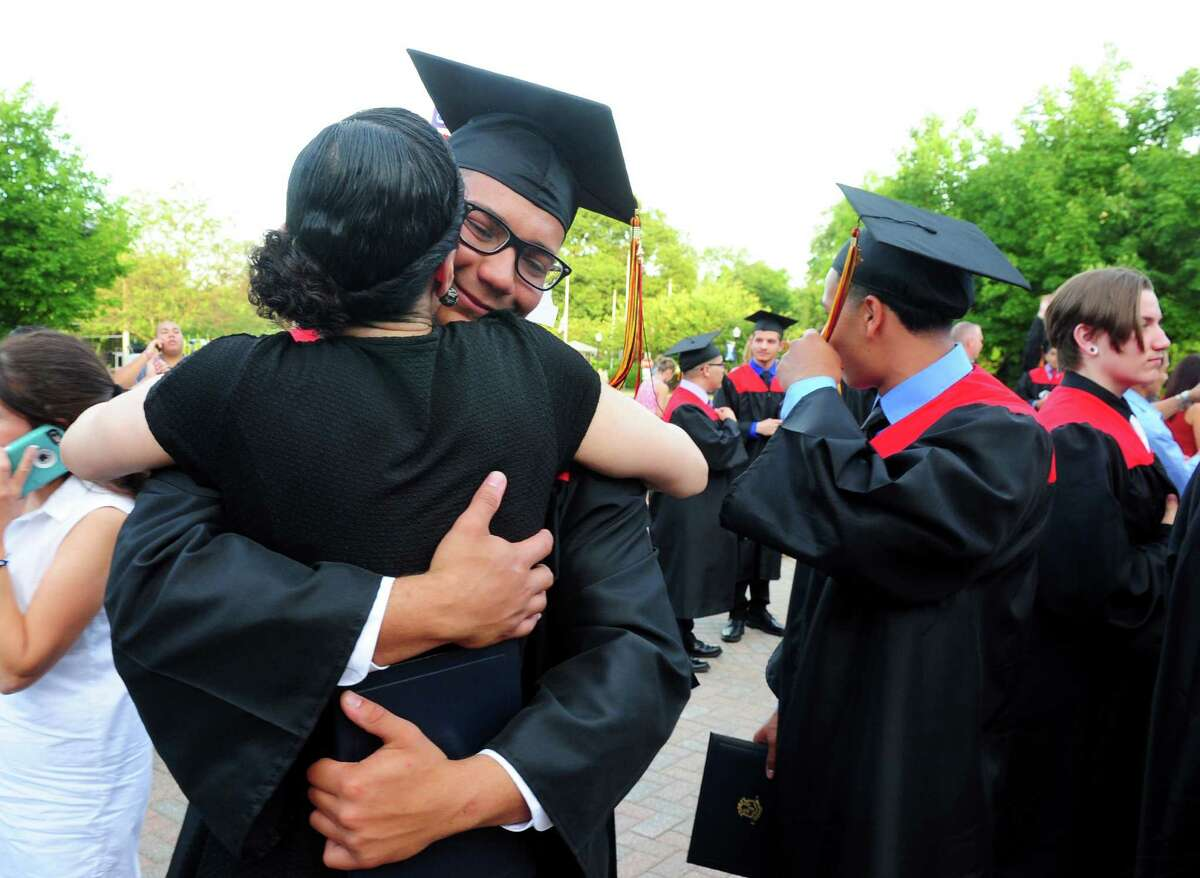 Daniel Homar gives his mom Diane a big hug after Platt Technical High School's Class of 2016 Graduation held at Lyman Auditorium at Southern Connecticut State University in New Haven, Conn., on Wednesday June 15, 2016.