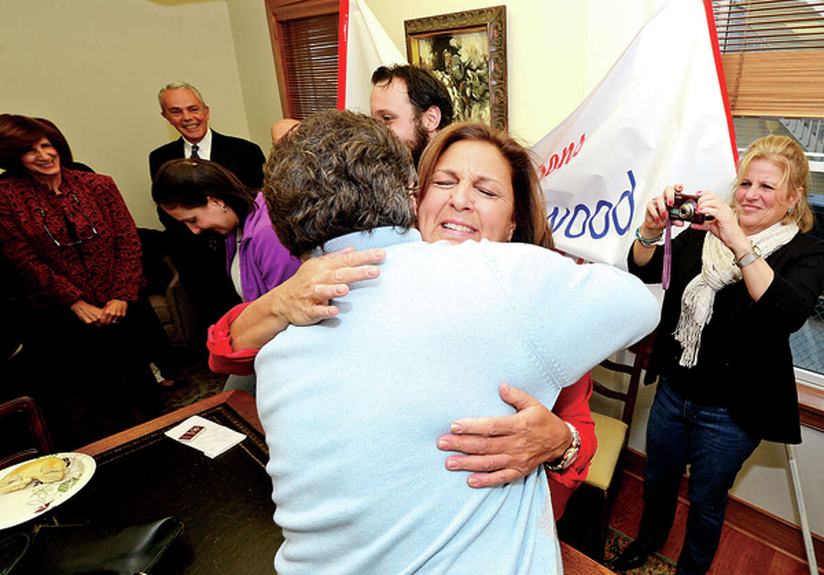 Jami Sherwood is surprised with being named City of Stamford Citizen of the Year as she is hugged by Lou Ursone during a morning reception at Redniss and Mead Thursday. Hour photo / Erik Trautmann