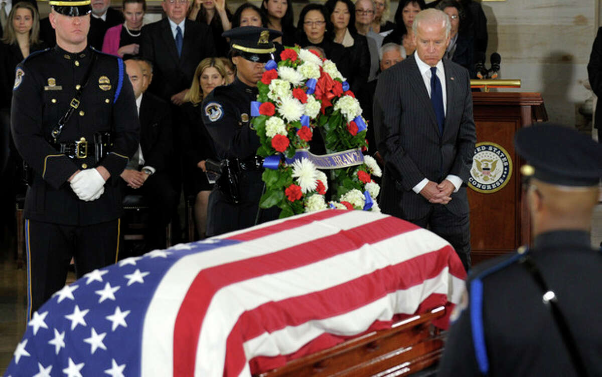 Vice President Joe Biden looks back as Sen. Daniel Inouye, D-Hawaii, the second-longest-serving senator in history, lies in state in the Capitol Rotunda in Washington, Thursday, Dec. 20, 2012. Inouye was a Medal of Honor recipient who represented his state in the U.S. House and then the Senate, where he served for five decades. He died Monday evening at age 88 of respiratory complications. (AP Photo/Susan Walsh)