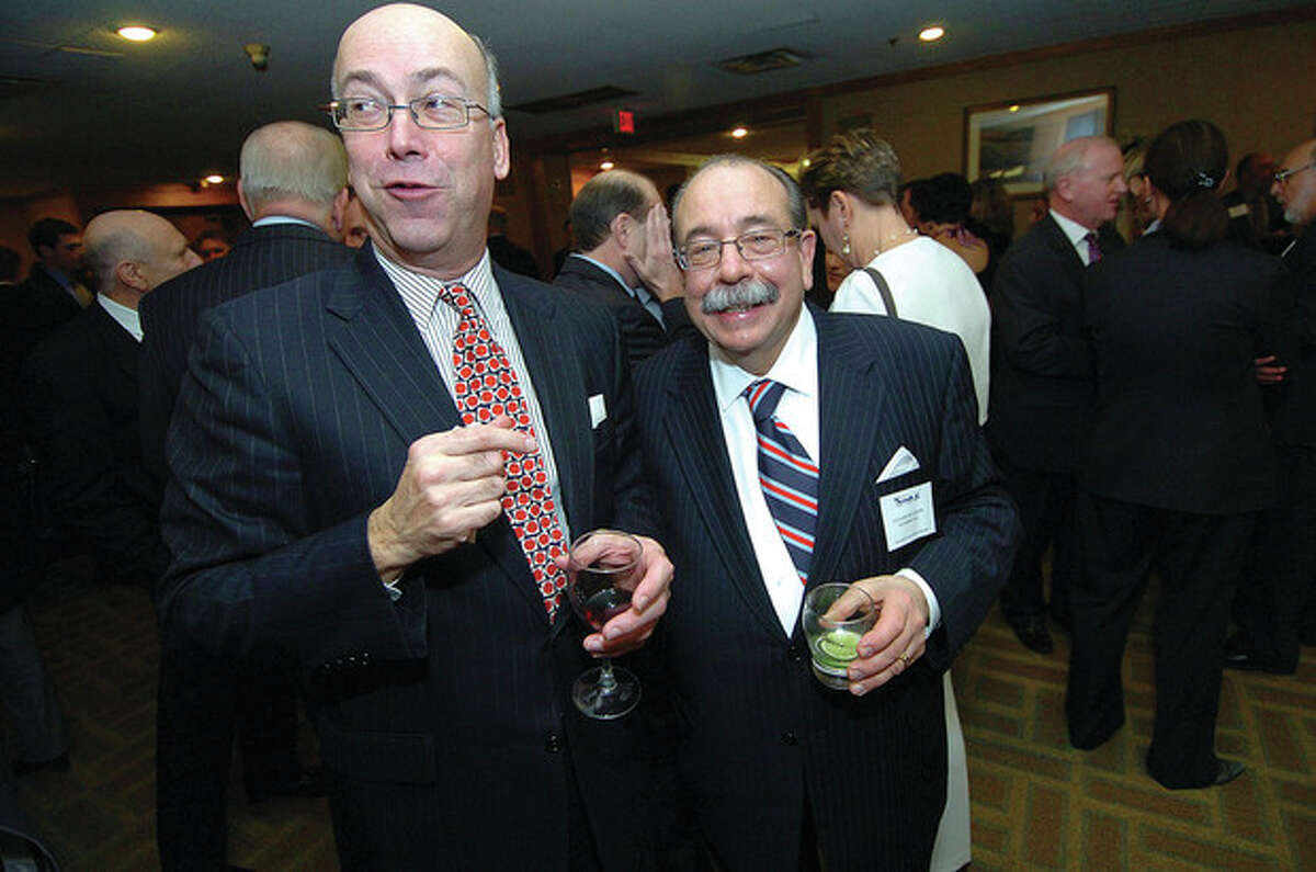 Hour Photo/Alex von Kleydorff. Chamber Chairman of the Board Harry Carey and Gus Sclafani Corps president Luciano Sclafani at the Chamber holiday dinner at Dolce
