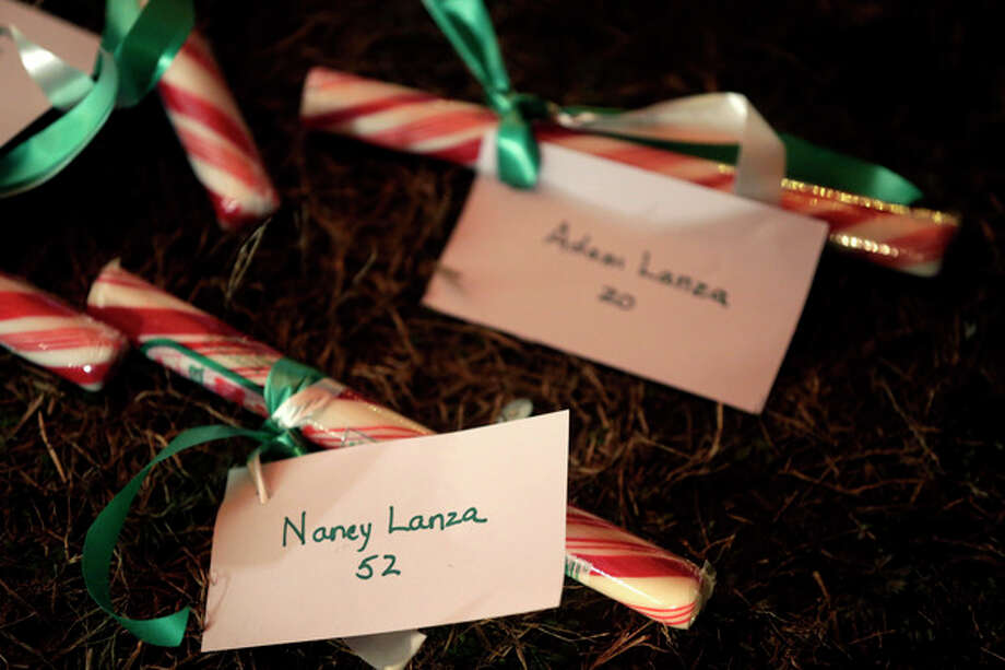 The names of Nancy Lanza and Adam Lanza are attached to candy at a memorial to the Newtown shooting victims in Newtown, Conn., Thursday, Dec. 20, 2012. Nancy Lanza's 20-year-old son, Adam Lanza, killed her at their home in Newtown, Conn., last week and then drove to Sandy Hook Elementary School, where he killed 20 children and six school employees before committing suicide. (AP Photo/Seth Wenig) / AP