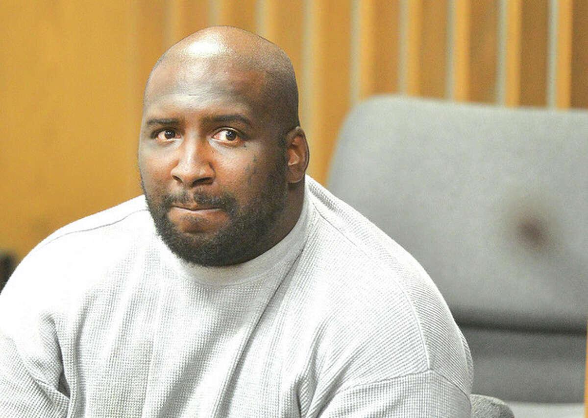 Hour photo / Alex von Kleydorff Bennie Gathers sits attentively while being arraigned in Norwalk Superior Court on Monday for allegedly robbing an ice cream man of $500.