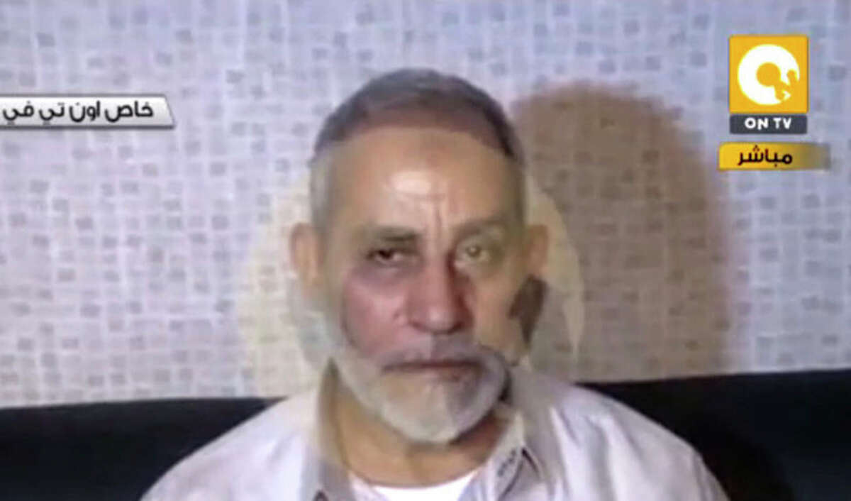 In this image taken from Egypt State TV, Mohammed Badie, the supreme leader of the Muslim Brotherhood, is seen after being detained by Egyptian security in Cairo, Egypt, Tuesday, Aug. 20, 2013. Egypt's military-backed rulers are pressing on in their crackdown against the Muslim Brotherhood with the arrest early Tuesday of the group's spiritual leader who had been in hiding near the huge sit-in in support of the country's ousted Islamist president, which security forces violently dispersed a week ago, leaving hundreds dead. (AP Photo/Egypt State TV)