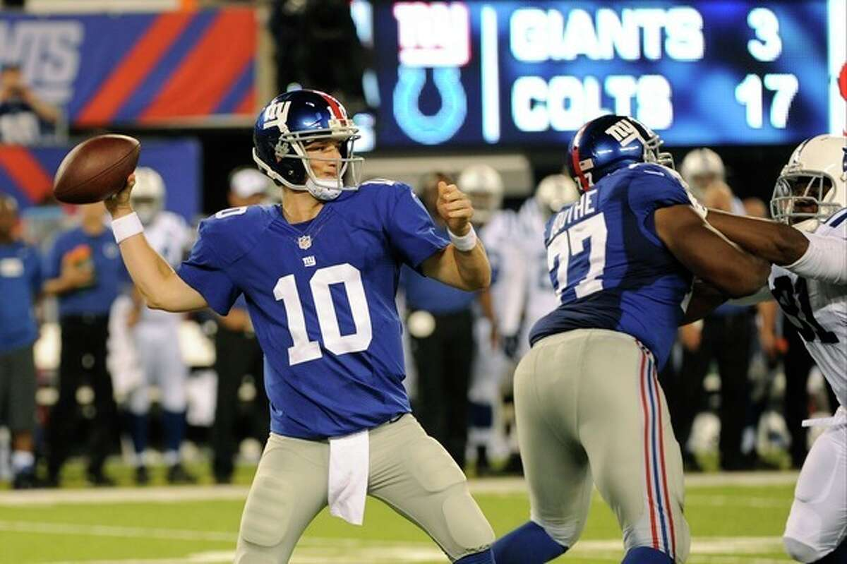 New York Giants quarterback Eli Manning (10) throws a pass during the first half of an NFL preseason football game against the Indianapolis Colts, Sunday, Aug. 18, 2013, in East Rutherford, N.J. (AP Photo/Bill Kostroun)