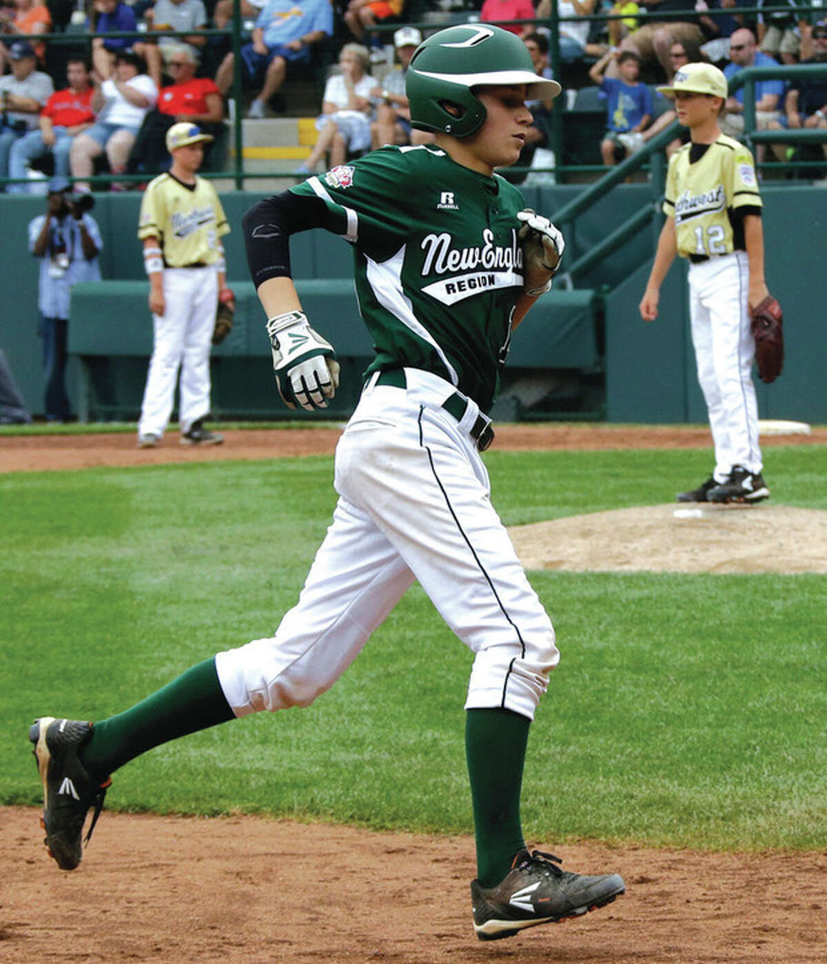 AP photo Harry Azadian rounds the bases after hitting a homer in Sunday's Little League World Series game. On Monday, Azadian was answering questions and chatting with ESPN SportsCenter anchr Karl Ravech.