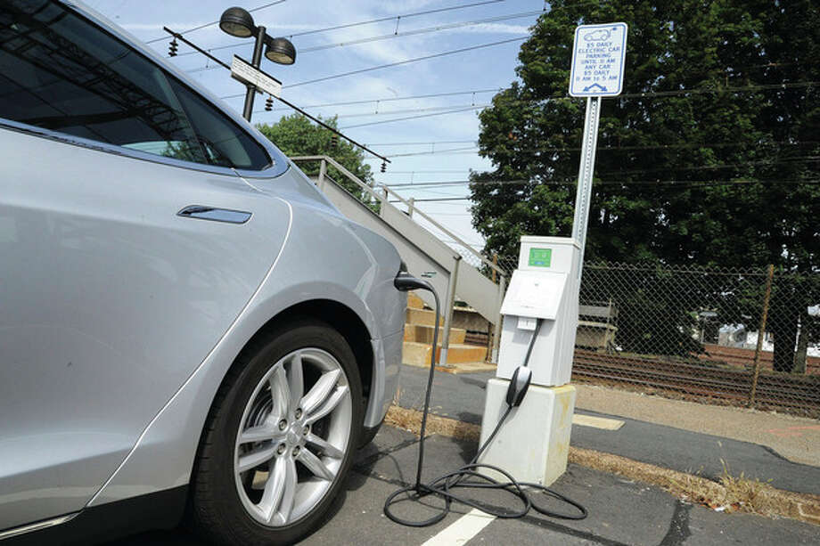 Hour photo/Matthew VinciA car charges Monday at the new charging station at the Saugatuck Train Station in Westport. / (C)2011 {your name}, all rights reserved