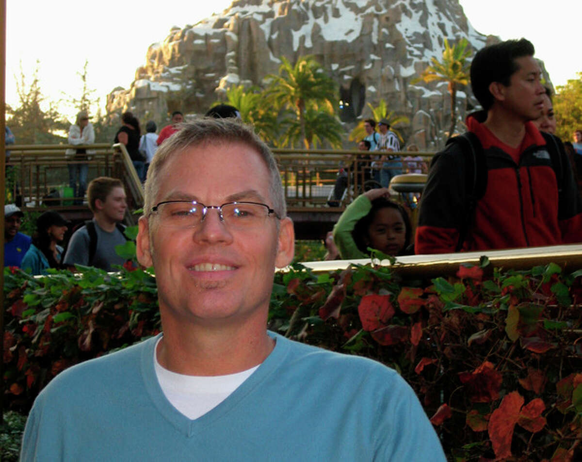 This handout photo provided by Charles Tripp, taken in 2012 shows liver transplant recipient William Sherbert at Disneyland in Anaheim, Calif. Sherbert of Garden Grove, Calif., temporarily moved from California, among the toughest parts of the country to get a donated liver, to Florida for a faster liver transplant. He recovered for his May 2012 transplant. (AP Photo/Charles Tripp)