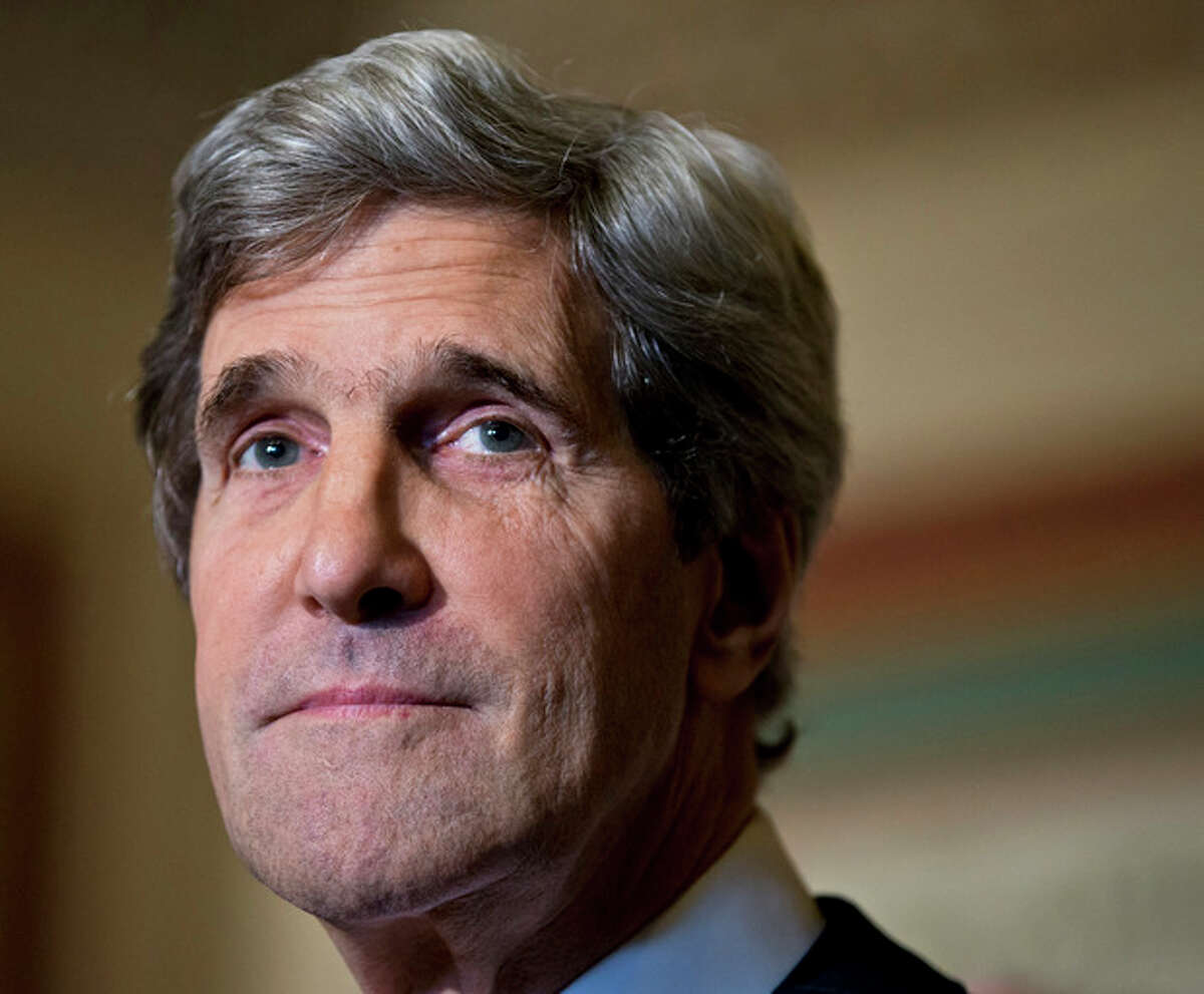 AP Photo/J. Scott Applewhite, File This Dec. 3 file photo shows Senate Foreign Relations Chairman Sen. John Kerry, D-Mass., at a news conference on Capitol Hill in Washington. Kerry stands tall as President Barack Obama's good soldier.