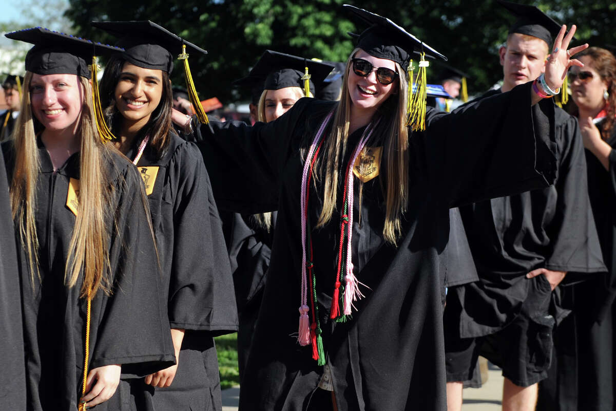 Jayce Barone and her graduating classmates enter Commencement Exercises for the Trumbull High School Class of 2016, held at the high school in Trumbull, Conn. June 15, 2016.