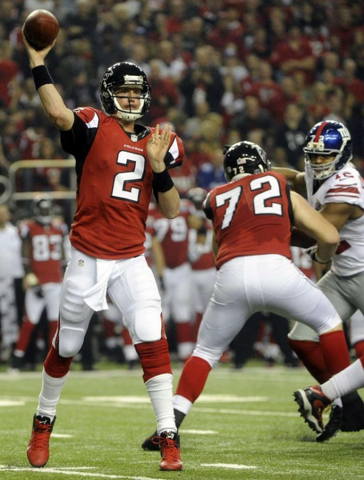 Atlanta Falcons quarterback Matt Ryan (2) works against the New York Giants during the first half of an NFL football game on Sunday, Dec. 16, 2012, in Atlanta. (AP Photo/John Amis)