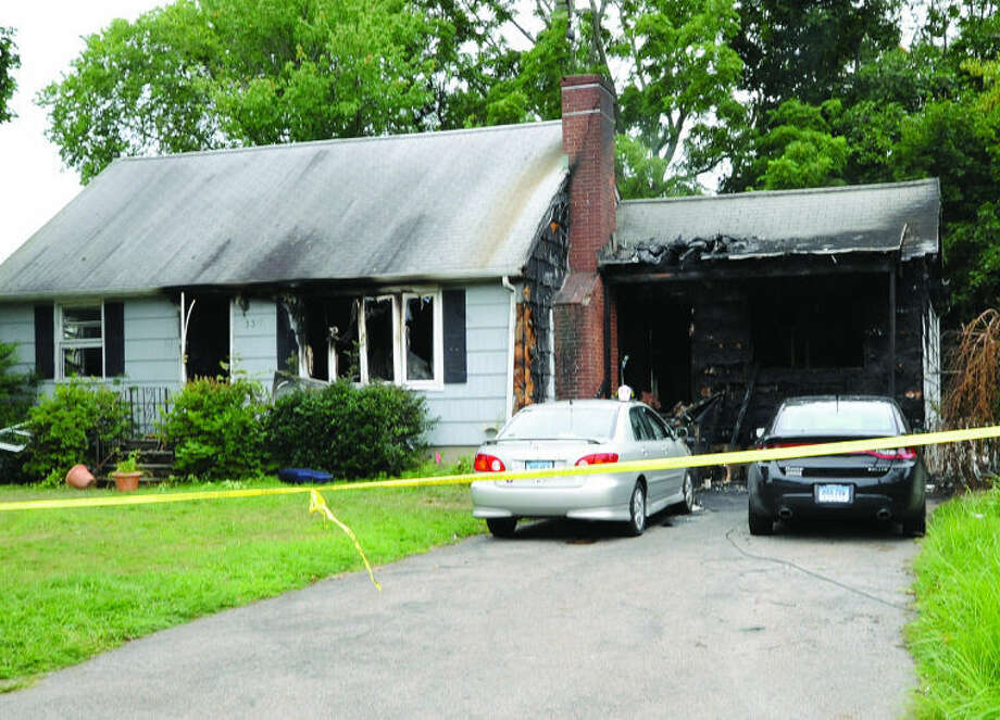 Fire destroyed a home on Pettom road Sunday morning. Hour photo/Matthew Vinci
