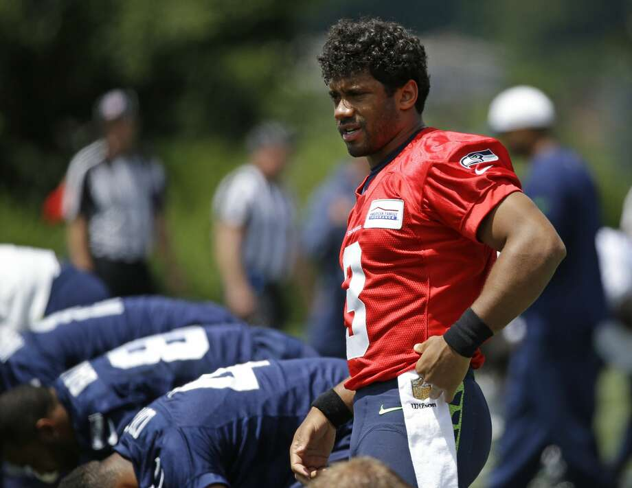 Seattle Seahawks quarterback Russell Wilson (3) stands as he stretches before NFL football practice, Wednesday, June 15, 2016, in Renton, Wash. (AP Photo/Ted S. Warren) Photo: Ted S. Warren/AP