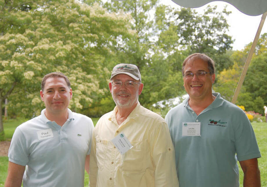 Pictured from left to right are: Paul Travaglino, president of the Bartlett Arboretum Board of Directors; Michael Larned, American Conifer Society member; and Larry Nau, president of the American Conifer Society.