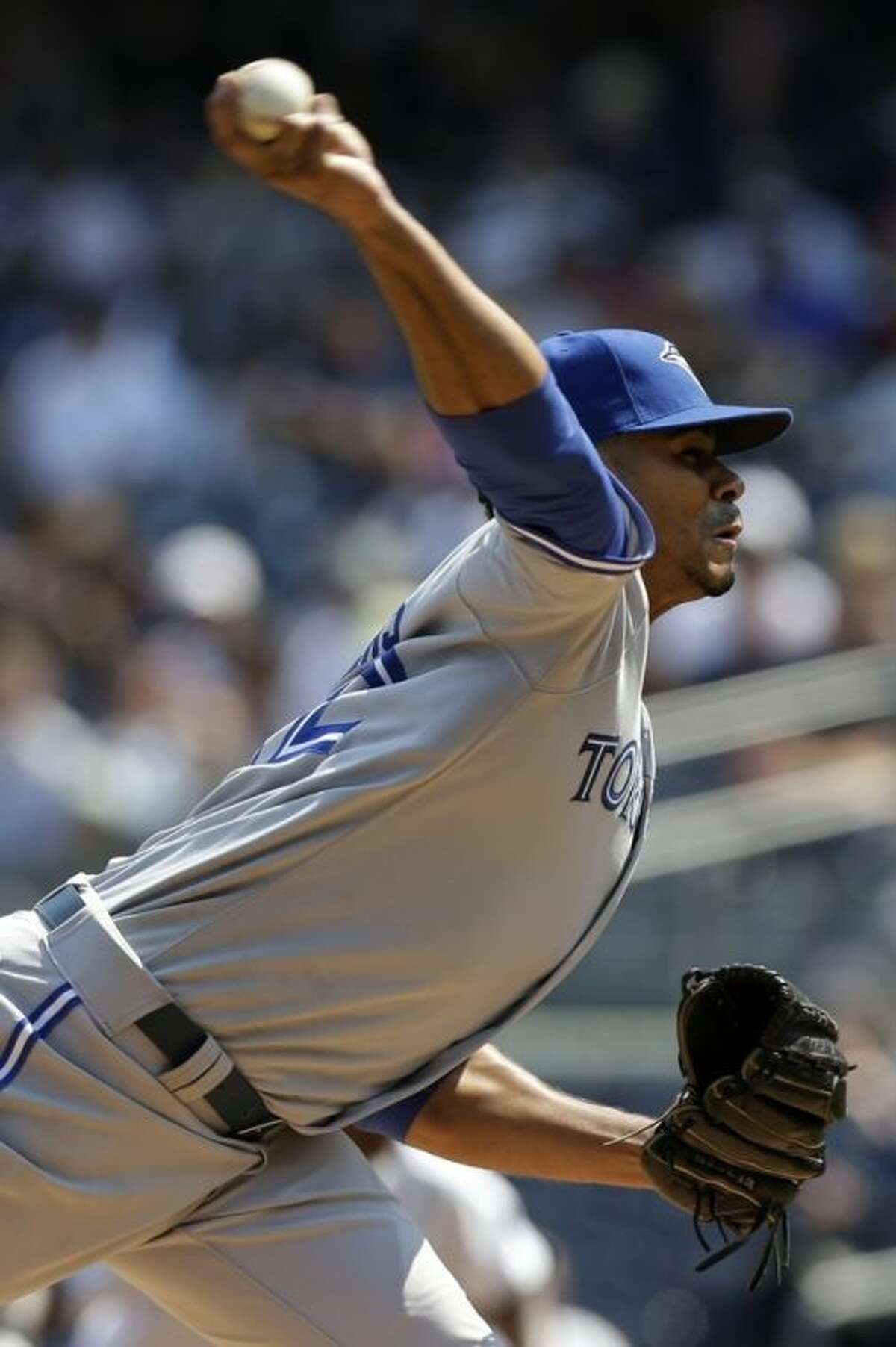 Toronto Blue Jays pitcher Esmil Rogers pitches during the second inning of a baseball game against the New York Yankees at Yankee Stadium Tuesday, Aug. 20, 2013 in New York. (AP Photo/Seth Wenig)