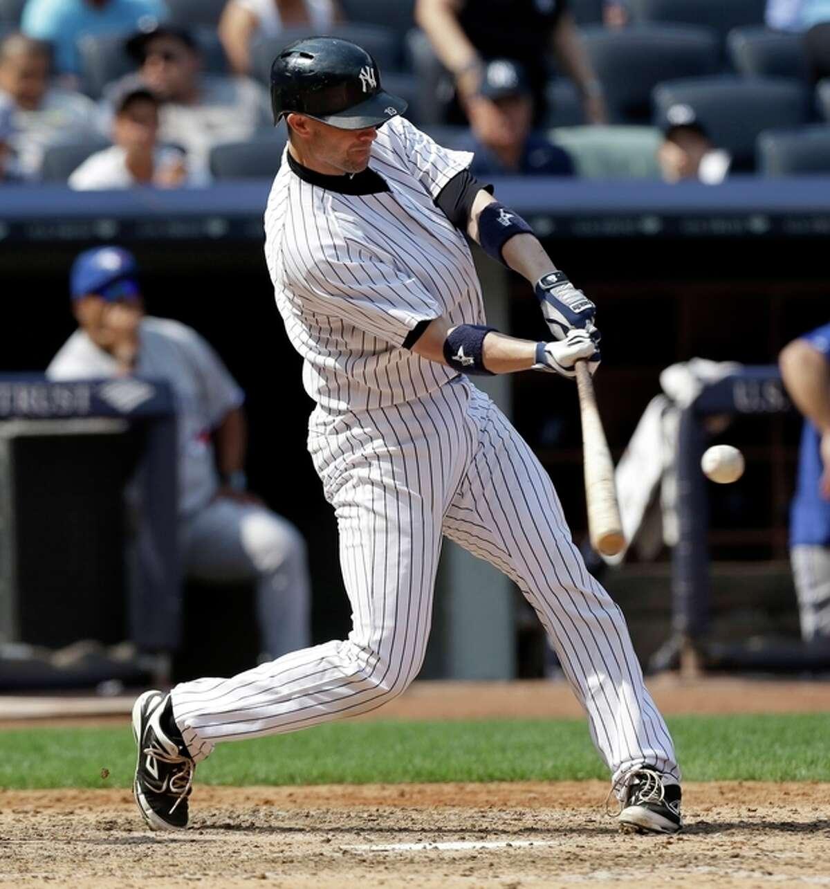 New York Yankees' Chris Stewart hits a three-run homer during the sixth inning of the baseball game against the Toronto Blue Jays at Yankee Stadium Tuesday, Aug. 20, 2013 in New York. (AP Photo/Seth Wenig)