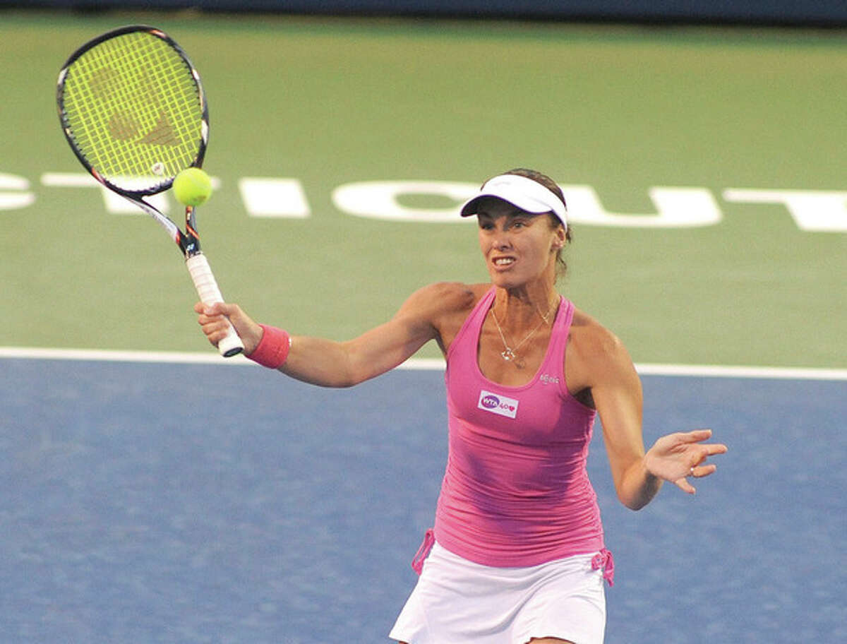 Hour photo/John Nash Martina Hingis looks to a volley a return out of the air during her doubles match at the New Haven Open on Tuesday night. Hingis, the former No. 1 player in the world, and her partner Daniela Hantuchova were defeated in straight sets by Cara Black and Vania King.