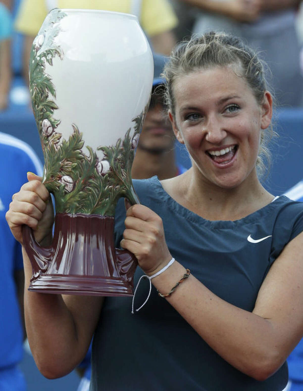 Victoria Azarenka, from Belarus, holds the championship trophy after she defeated Serena Williams, 2-6,6-2, 7-6 (6) to win the Western & Southern Open tennis tournament, Sunday, Aug. 18, 2013, in Mason, Ohio. (AP Photo/Al Behrman)