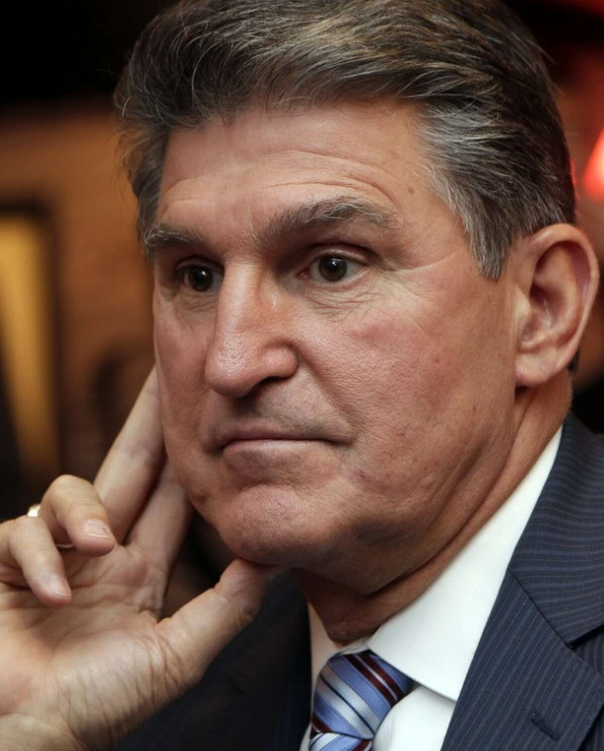 FILE - In this Nov. 6, 2012 file photo, Sen. Joe Manchin, D-WV., watches vote returns at his election watch party in Fairmont, W. Va. On Monday, Sen. Joe Manchin, a lifelong member of the National Rifle Association, said it was time to discuss gun policy and move toward action on gun regulation. (AP Photo/Dave Martin)