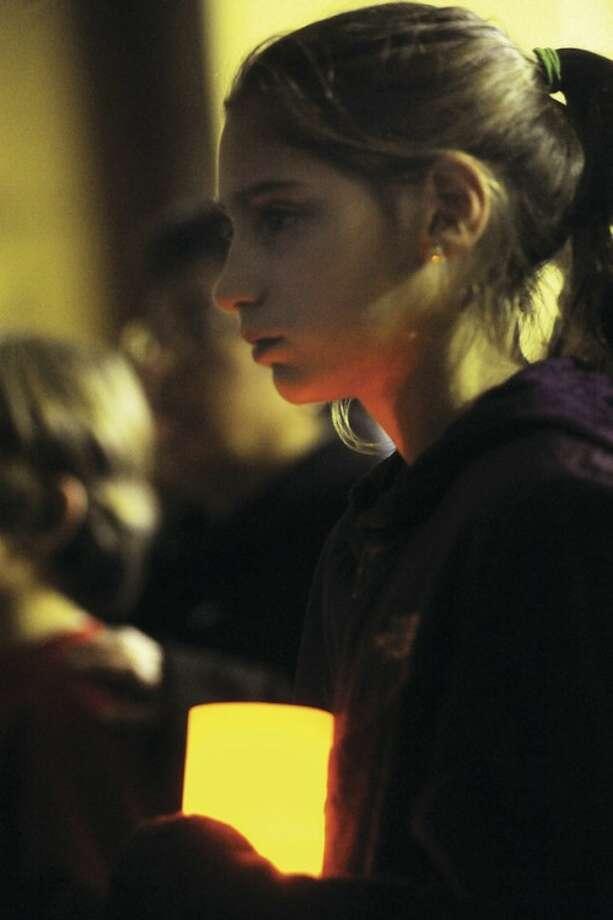 Naramake student Breann Memoli attends the vigil in honor of the victims of Sandy Hook Elementary School Sunday. hour photo/Matthew Vinci