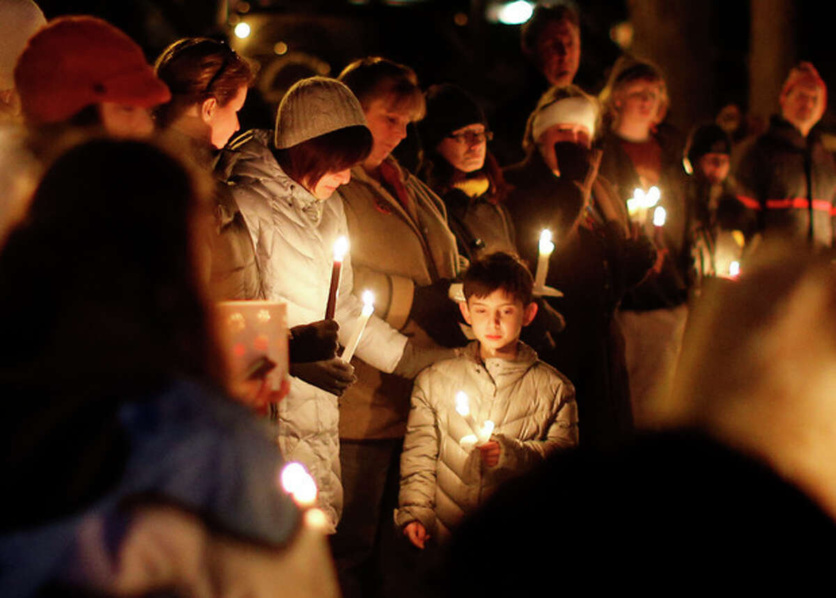 AP Photo/Jason DeCrow Mourners gather for a candlelight vigil at Ram's Pasture to remember shooting victims, Saturday, Dec. 15 in Newtown, Conn. A gunman walked into Sandy Hook Elementary School in Newtown Friday and opened fire, killing 26 people, including 20 children.