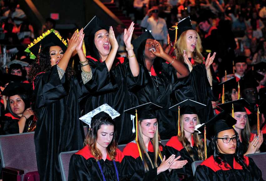 Graduates cheer for their fellow classmates during Platt Technical High School's Class of 2016 Graduation held at Lyman Auditorium at Southern Connecticut State University in New Haven, Conn., on Wednesday June 15, 2016.