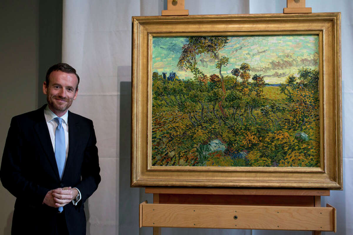 CAPTION CORRECTION, CORRECTS SPELLING OF SURNAME TO REFLECT AP STYLE - Van Gogh Museum director Axel Rueger, left, poses next to