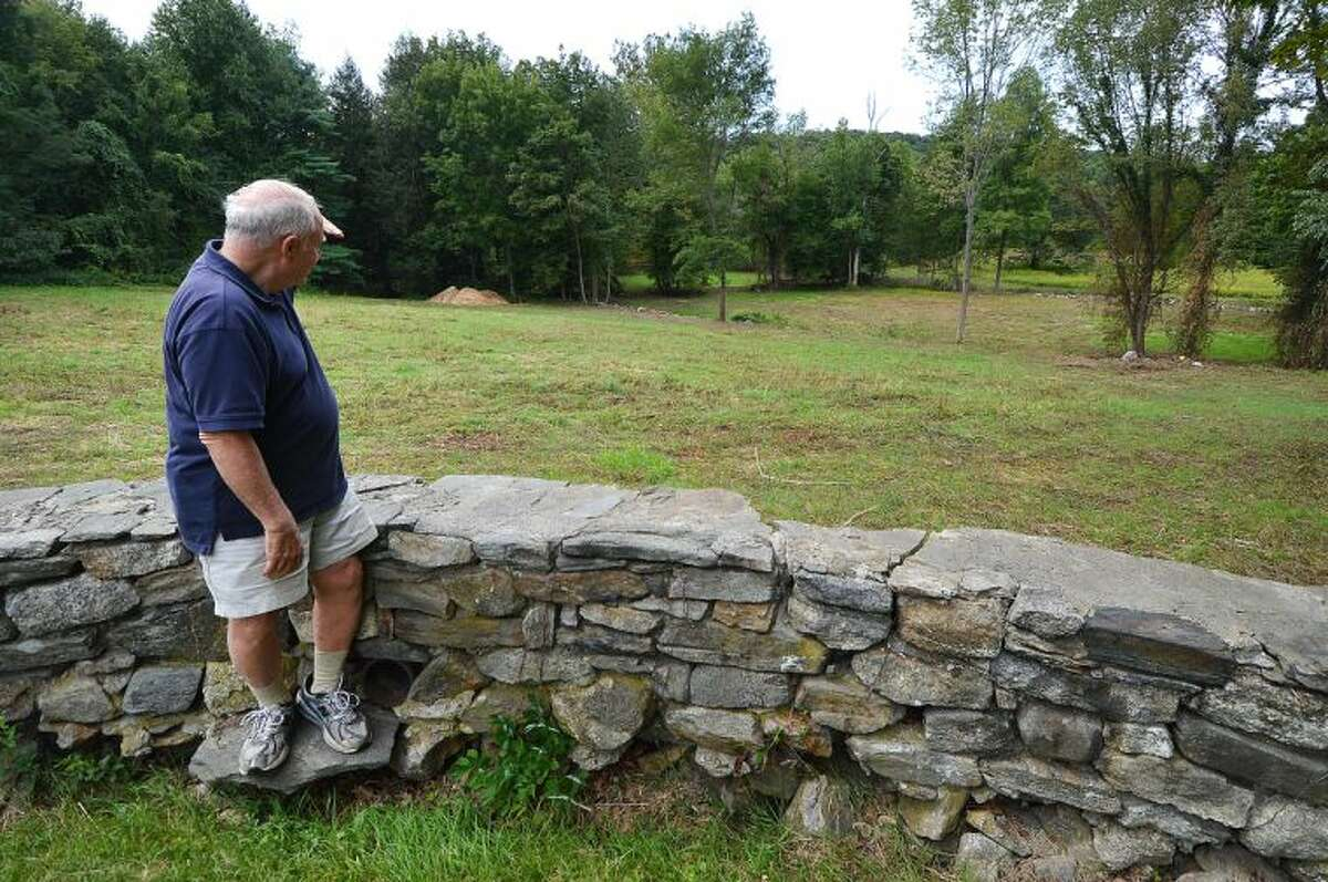 Hour Photo/Alex von Kleydorff. Bob Russell spots a deer on the Keiser Property in Wilton